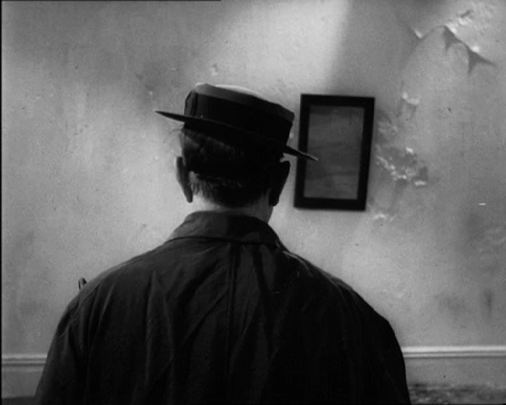 Buster Keaton op de rug gefilmd in Becketts 'Film' (1964).